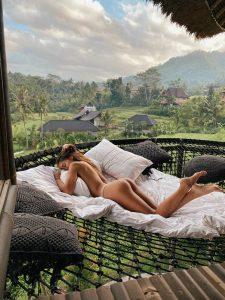 Girl sleep on the hammock of the bamboo villa